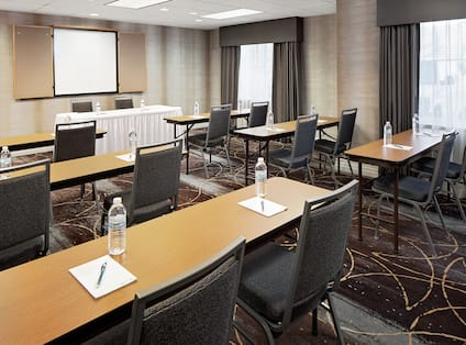 Meeting Room with Long Tables, Chairs, and Room Technology