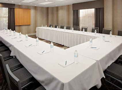 Meeting Room with U-Shaped Table and Chairs