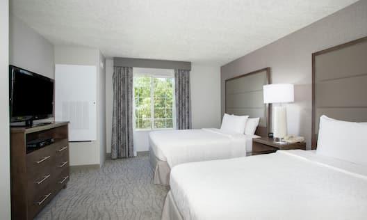 Guest Suite Bedroom with Double Queen Beds
