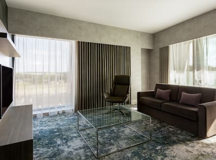 Presidential Suite Living Room with Sofa and HDTV