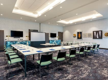 Meeting Room Setup in U Style with Projection Screen and 2 HDTVs
