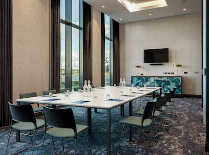 Meeting Room with HDTV and Large Windows