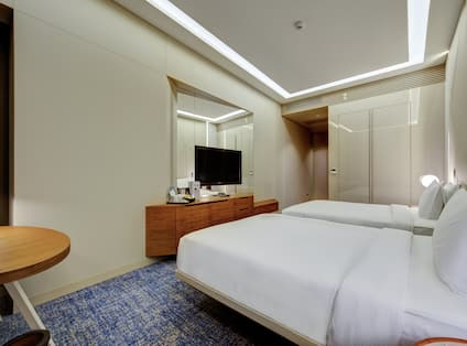 Guest Room with Two Beds and HDTV