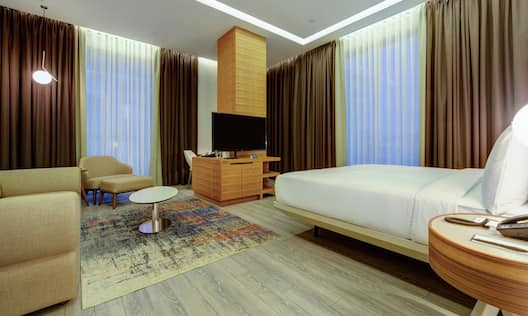 Guest Room with HDTV and Soft Seating Area