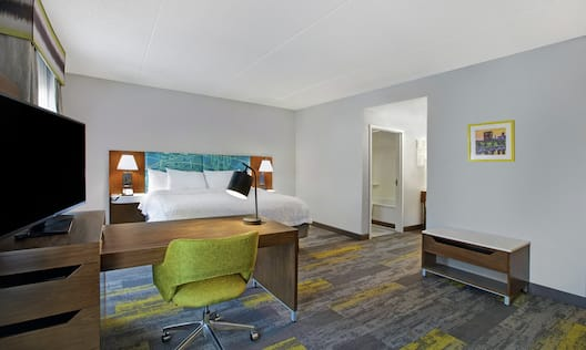 One King Bed Guest Suite with TV and Work Desk