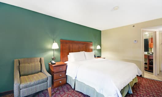 Guest Room with King Bed and Lounge Chair