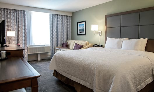 Room with Bed, TV, Work Desk, and Couch