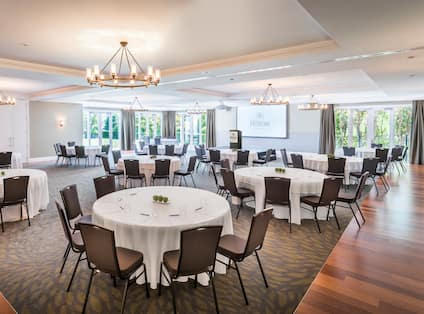 Spacious Ballroom Dining Area with Projector Screen