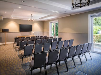 Meeting Room Theatre Setup with Wall Mounted HDTV
