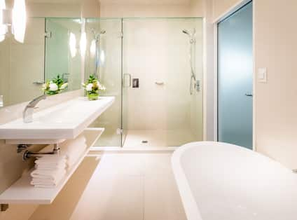 Suite Bathroom with Large Tub and Separate Shower