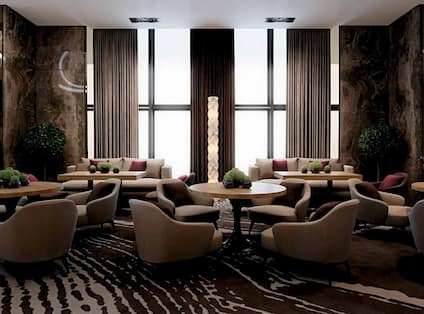 Lobby Seating Area with Armchairs, Tables and Sofas
