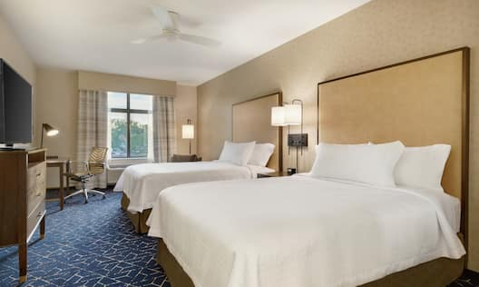 Two Queen Beds, Work Desk, Chairs, TV, and Outside View in Suite Bedroom