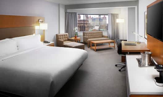 Guestroom with King Bed, Lounge Area, Outside View, Work Desk, and Room Technology