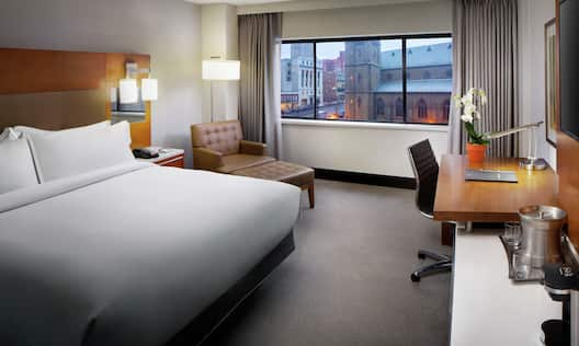 Accessible King Guestroom with Lounge Area, Outside View, Room Technology, and Work Desk
