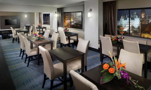 Executive Club Lounge with Tables and Chairs