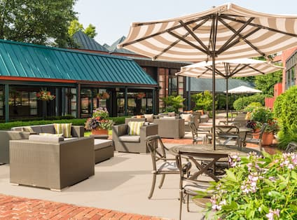 Outdoor seating area with tables and chairs