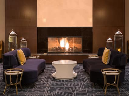Fireplace in lobby with comfortable seating
