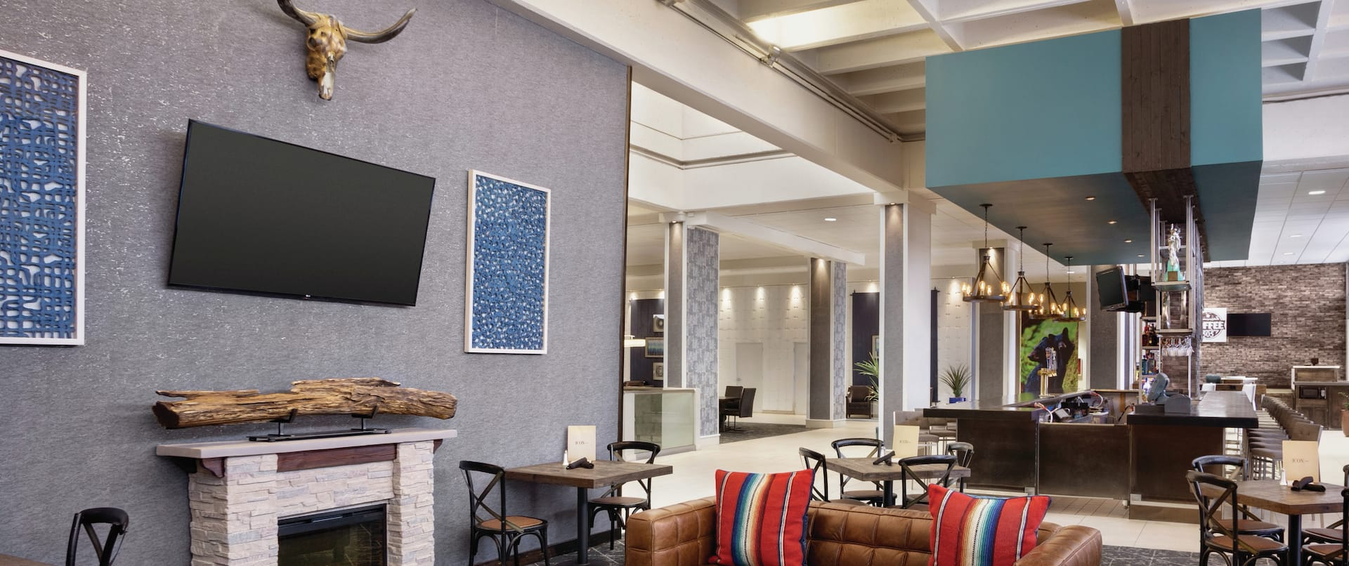 Bar Lounge Seating Area with Sofas, Fireplace and Wall Mounted HDTV
