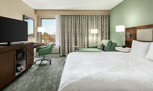 Accessible King Guestroom with Bed, Lounge Area, Outside View, Work Desk, and Room Technology