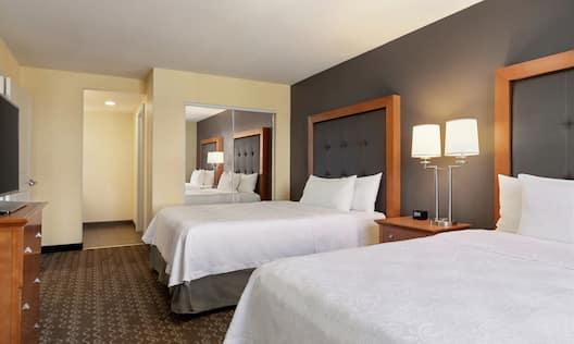 Double Queen Guest Suite Bedroom