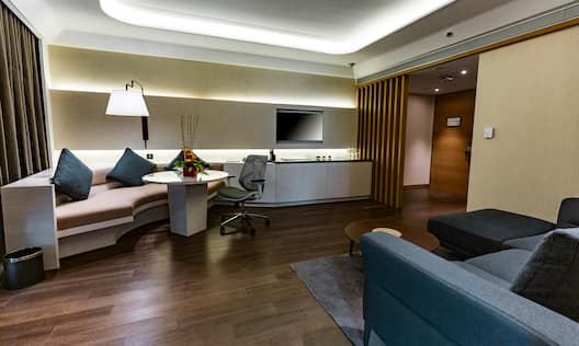 Suite living area with comfortable seating