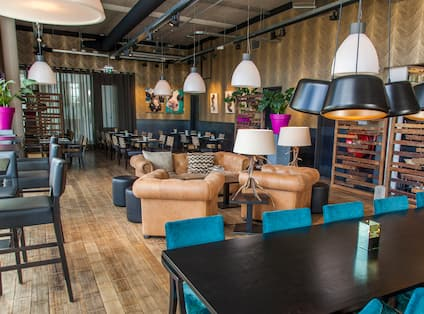 View of Mixed Seating, Decorative Lighting and Wall Art in Restaurant Brooklyn