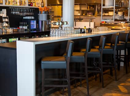 View of Seating at a Fully Stocked Bar