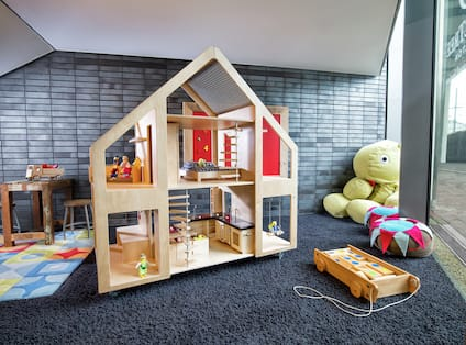 a room with a playhouse and toys