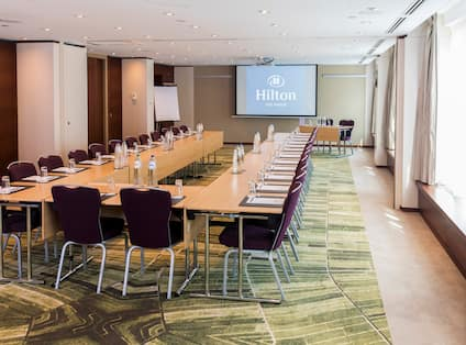 Meeting Room with Projection Screen Setup U Style