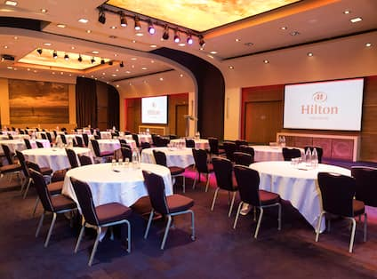 Meeting Room Setup Cabaret Style with Two Projection Screens