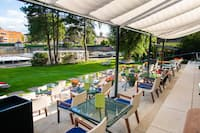 Garden Terrace with Tables and Chairs under Awning