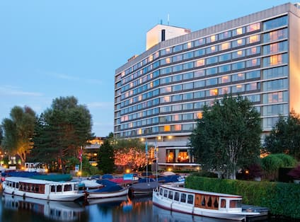 Hotel exterior with canal in foreground