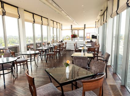 Executive lounge area with tables and chairs