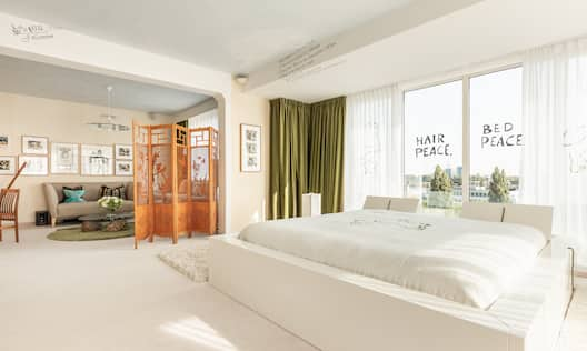 Bed in room with green curtain