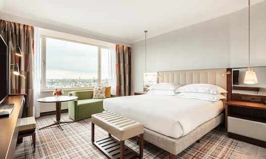 Bed in room with table and chairs