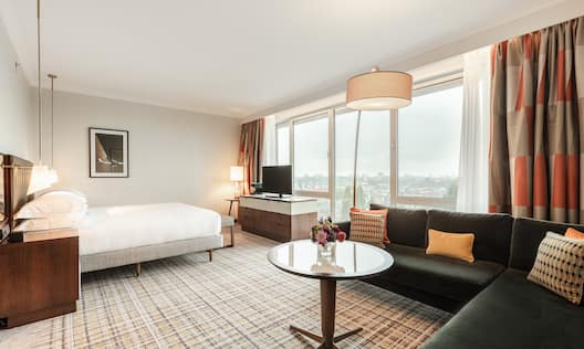 Suite area with comfortable seating and bed