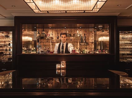 Bar Area with Bartender Serving a Drink