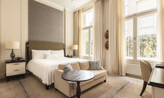 King Suite with Sofa Desk and Large Windows