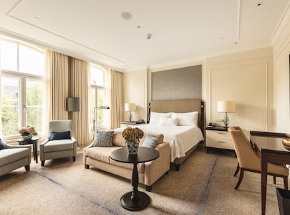 Roell Suite Bedroom with Work Desk Sofa and Seating Area