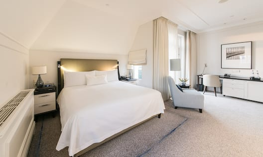 Bed in room with chair