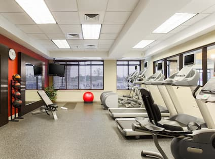 Fitness center with treadmills and other equipment.