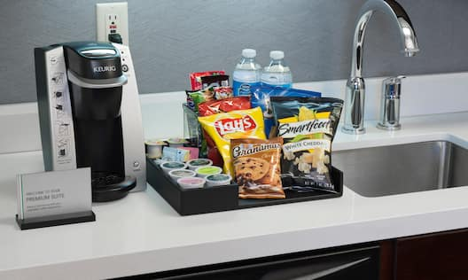 Coffeemaker and Snacks on Counter in Guest Room