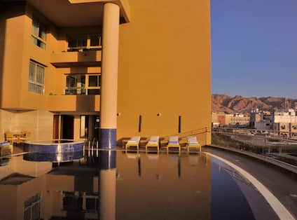 Infinity Outdoor Pool With Lounge Area Seating