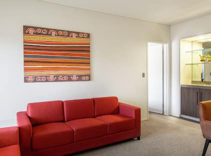 Guest Room Living Area with Two Red Sofas