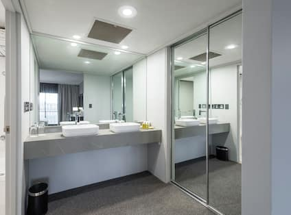 Suite Bathroom with Dual Vanity Area and Large Mirror