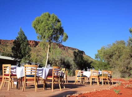 Round Tables With White Cloths Set For Dinner Event at Alice Springs Desert Park