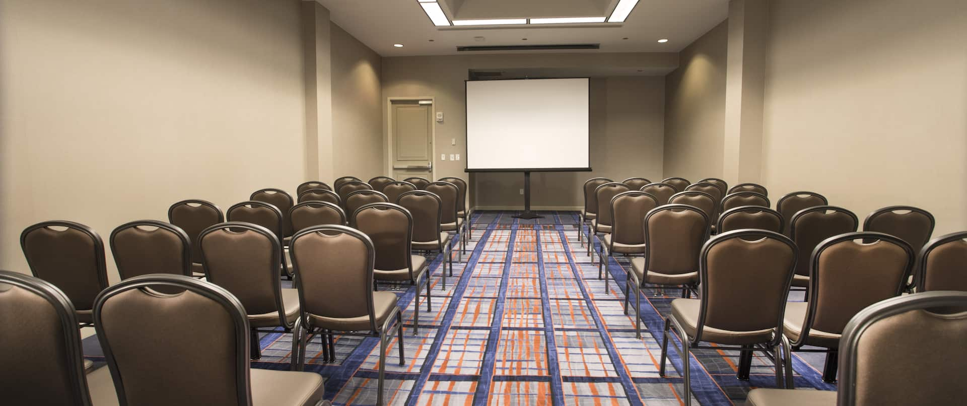 Meeting Room Theater Setup with Projector Screen