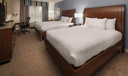 Two Queen Guest Rooms Feature Two Queen Beds, a Work Desk with Office chair and an HDTV