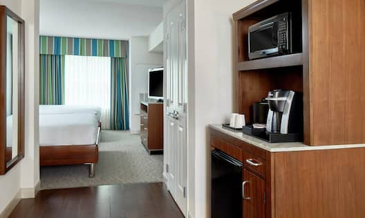 Kitchenette with Keurig Coffeemaker, Microwave, and Mini-Fridge in Two Queen Bed Junior Suite