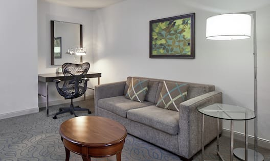 Sofabed and Work Desk with Ergonomic Chair in Junior Suite Living Area